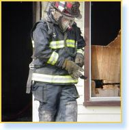 Firefighter adjusts gloves